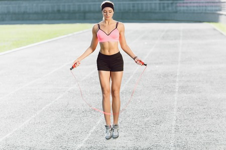 Young girl jumping on skipping rope