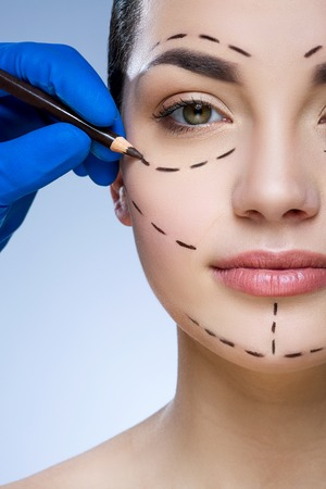 Perforation lines on patients face Imagens