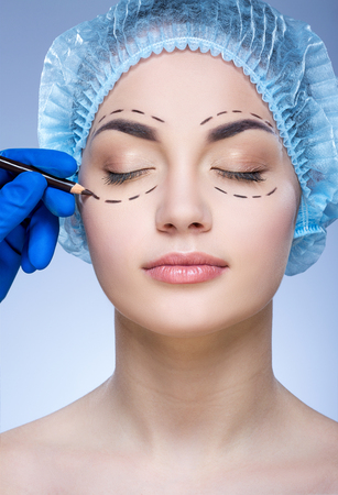 Beautiful girl at plastic surgeon Imagens