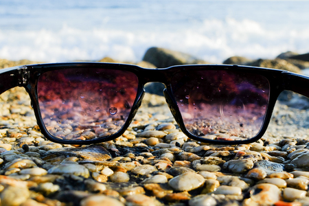 Sunglasses at sea background