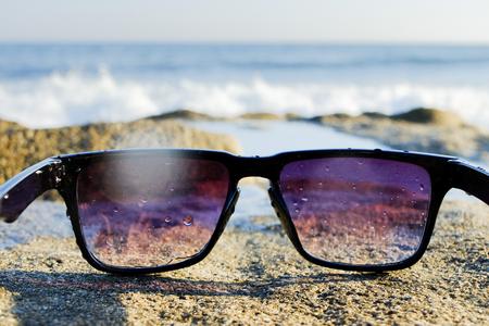 Sunglasses at sea background