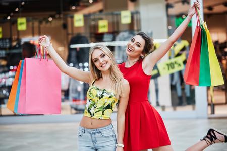 Pretty girls posing while shopping