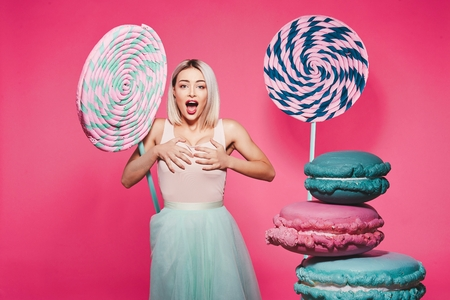 Pretty girl posing with huge lollypops