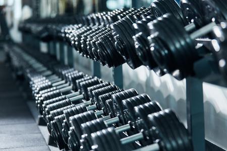 Photo of dumbbells in gym, portrait, sport concept, healthy lifestyle, gym concept, motivation.