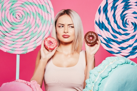 Blonde girl posing with sweets