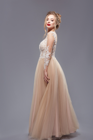 pretty lady with red lips in elegant evening dress