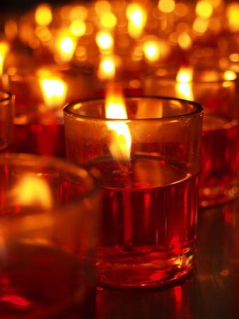 The burning candles on black background Stock Photo - 12424066