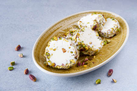 Traditional arabic ice cream with pistachio booza. Close up