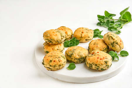 Homemade buns with fresh herbs and cheese. Top view with copy