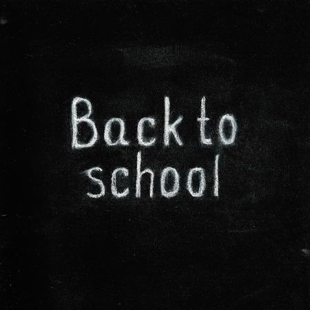 Back to school chalk text on blackboard