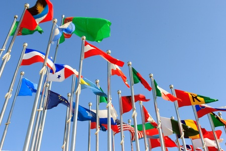 coalition: different countries flags united together against blue sky  Stock Photo