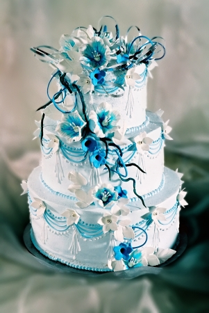 Beautifully decorated wedding cake with blue flowers photo