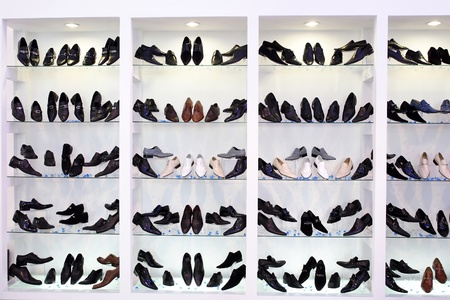 Mens shoes on glass shelfs