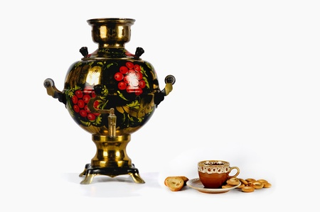 Traditional Russian Samovar, cup of tea and wheels on the white background Stock Photo - 12207730