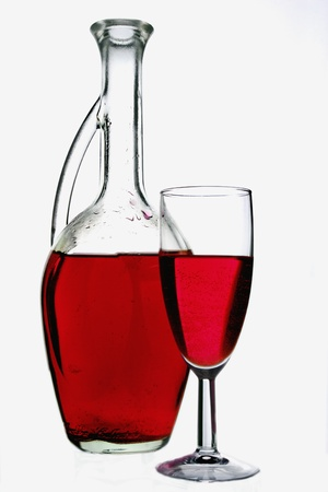 Glass pitcher with red liquid.  photo