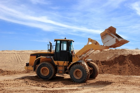 Yellow Bulldozer at Construction Desert Chanel photo