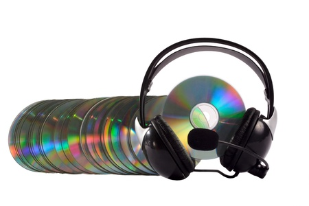 Headphone and cd collection as a caterpillar isolated on white background photo