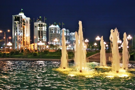 Fountains and night town. Ashkhabad. Turkmenistan.