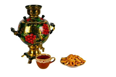 Traditional Russian Samovar, cup of tea and wheels on the white background photo