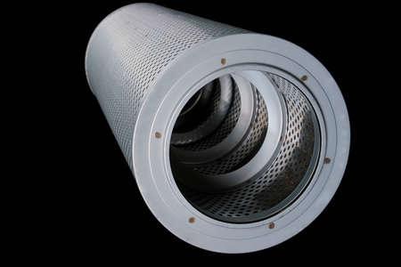 Brand new automotive oil filter cartridge on black background Stock Photo - 12650045