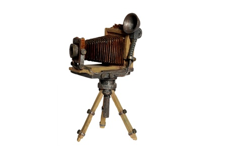 antiquities: Model of old photographic camera on white background