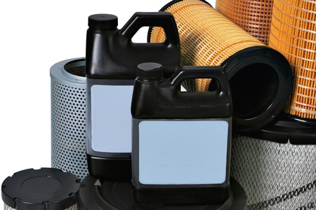 lubricate: New automotive oil filter cartridge and plastic can Stock Photo