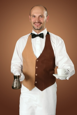 percolator: Waiter in uniform with percolator and cup of coffe