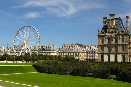 Park outside the Louvre in Paris  Ferris wheel at Jardin de Tuileries in Paris, France Stock Photo