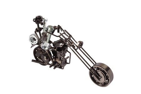 Toy  motorbike made from bolts and nuts carrying bolts and nuts    Stock Photo