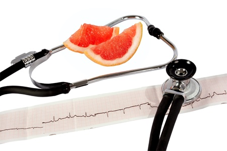 sinusoidal: Phonendoscope and cardiogram with grapefruit Stock Photo