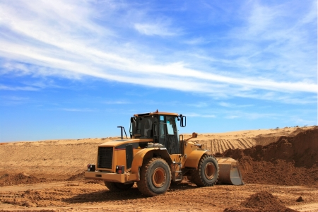 Yellow Bulldozer at Construction irrigation canal in Desert Stock Photo