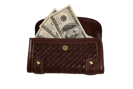 spender: Purse with cash isolated over white background