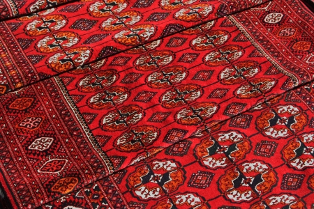 Few handmade carpets with traditional ornament. Turkmenistan. Ashkhabad market.