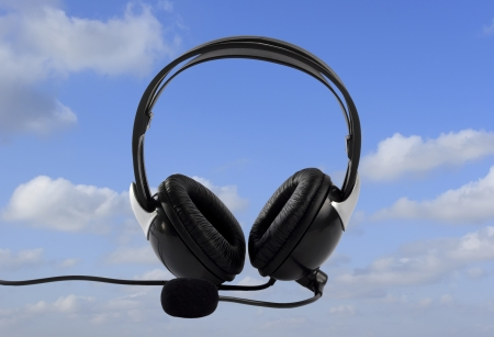 Headphone on blue sky as a background Stock Photo - 13912200