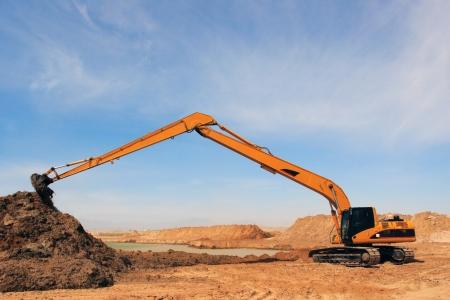 Orange excavator at construction site