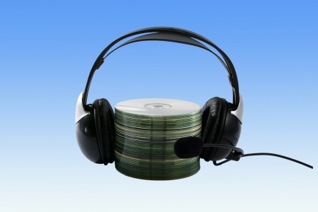 Headphone and cd collection on gradient as a background photo