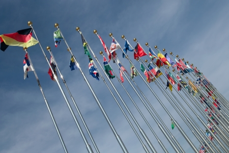 Different countries flags united together against blue sky  Stock Photo