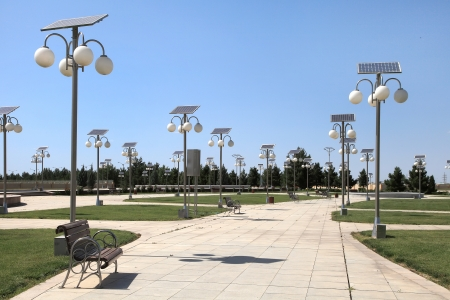 street lamp: Alley in the park with a solar-powered lanterns Stock Photo