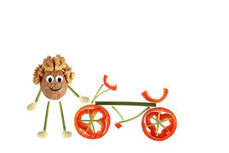 Healthy eating  Little funny walnut with bicycle  photo