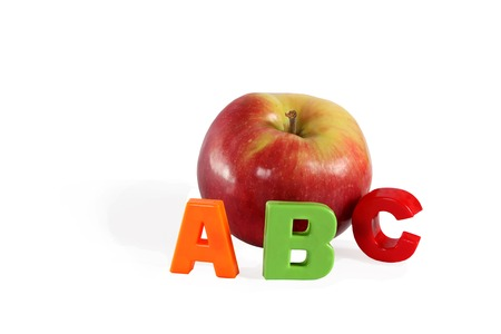 Illustrated alphabet letter A and apple. photo
