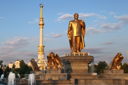 Monumen of Niyazov and Arch of Independence in sunset  Ashkhabad  Turkmenistan