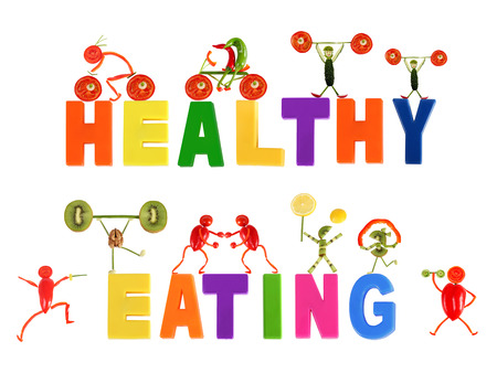Healthy eating. Little funny people made of vegetables and fruits. Stock Photo