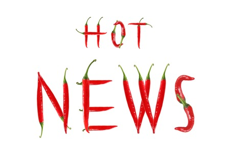 HOT NEWS text composed of chili peppers. Isolated on white background photo