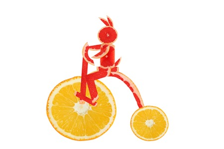 Healthy eating. Funny vintage bike  made of the orange  slices with  little rabbit photo