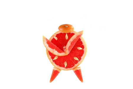 Healthy eating. Funny alarm clock made of the grapefruit slices. photo