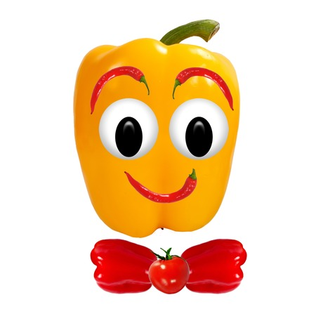 Healthy eating  Funny face made of vegetables and fruits with open-eyed photo
