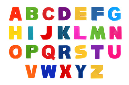 Alphabet written in multicolored plastic kids letters Stock Photo