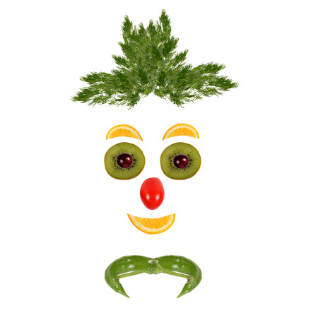 Healthy eating. Funny face made of vegetables and fruits photo