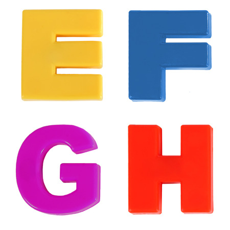 Four letters written in multicolored plastic kids letters photo