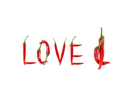 Picture of the word love written with red chili peppers photo